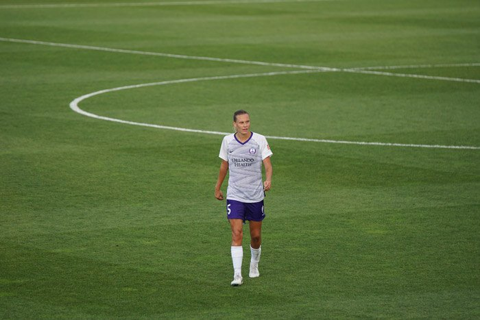 A soccer photography shot of a player on the field