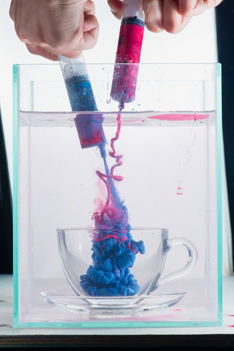 Overhead shot of mixing paint to shoot colorful paint in water photography