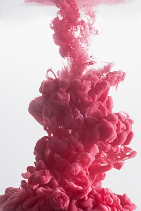 A pink cloud using colorful paint in water technique