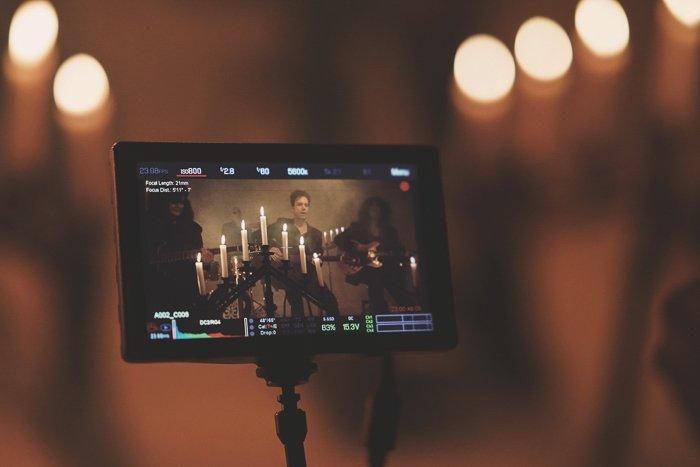 Atmospheric concert photography seen through a device screen