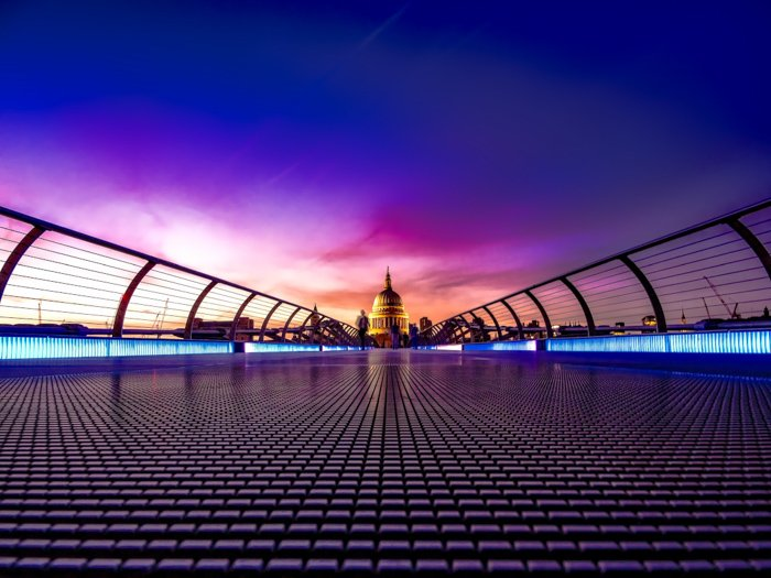brightly colored shot of a city bridge at sunset enhanced using free hdr software