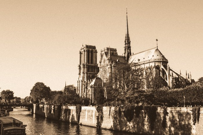 A vintage sepia tone image of the Notre Dame Cathedral in Paris
