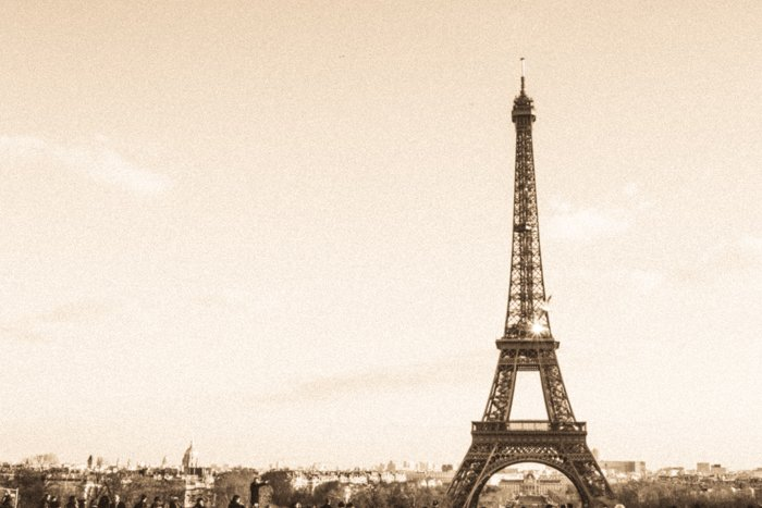 A sepia tone image of the Eiffel tower in Paris