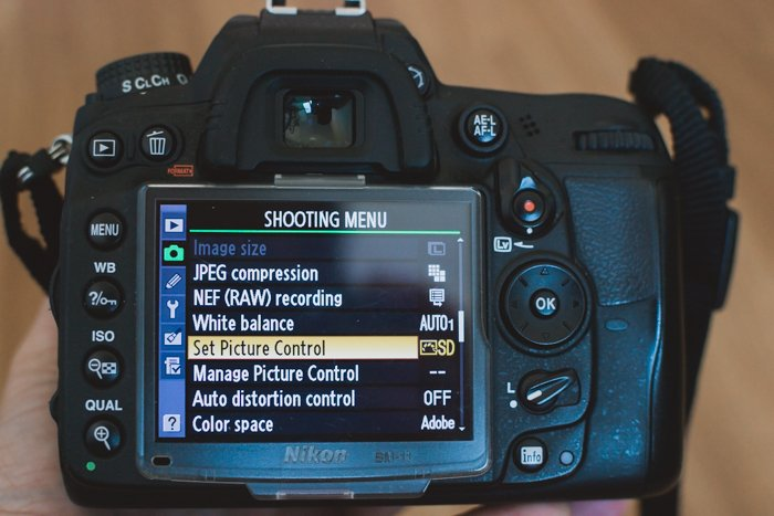 the settings on a Nikon DSLR showing how to shoot in sepia tone
