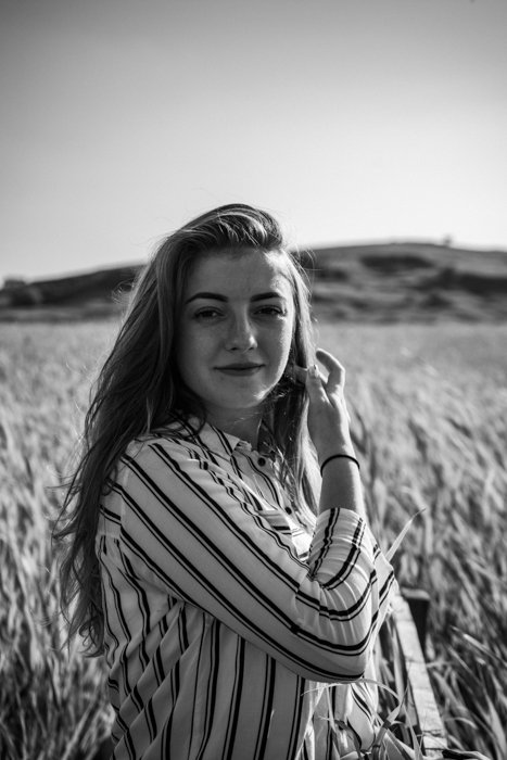black and white vintage portrait of a female model posing outdoors