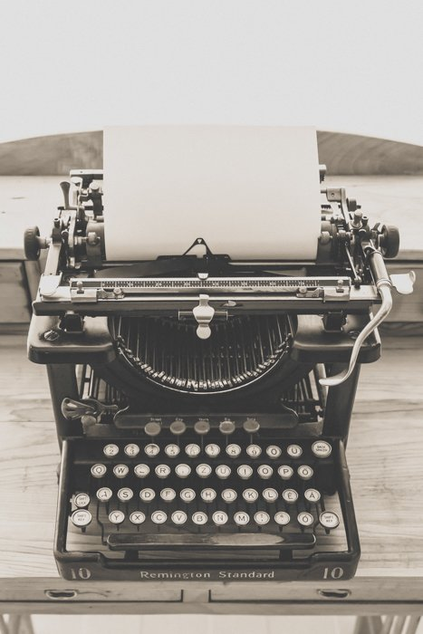 a black and white still life of an antiques typewriter - vintage photography tips
