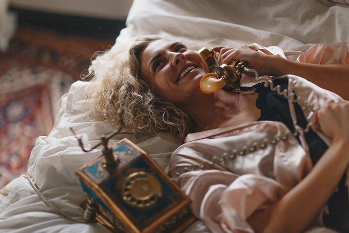 sensual portrait of a female model using boudoir photography props