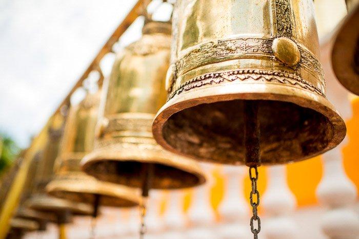 a row of golden bells shot at a dutch angle