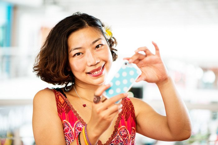 a female model taking photos using dutch angle composition