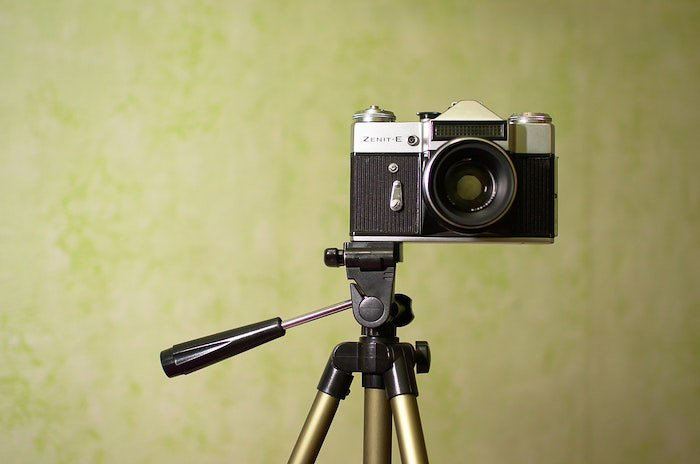Close up ecommerce photography of an antique aperture camera on a tripod