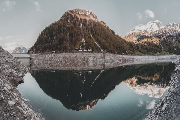 Photo of a mountain reflecting on a waterscape