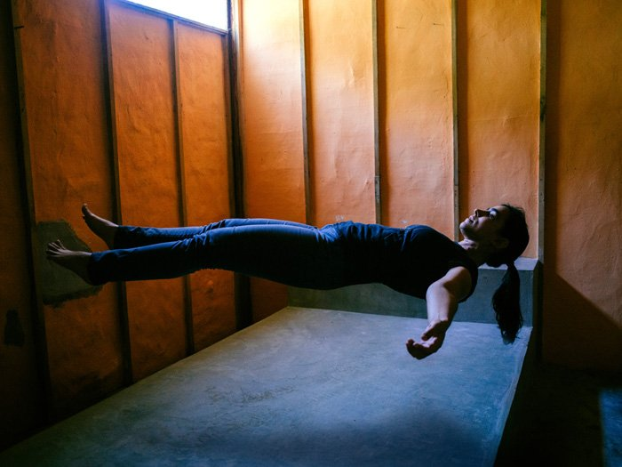 A cool levitation photo of a floating female model