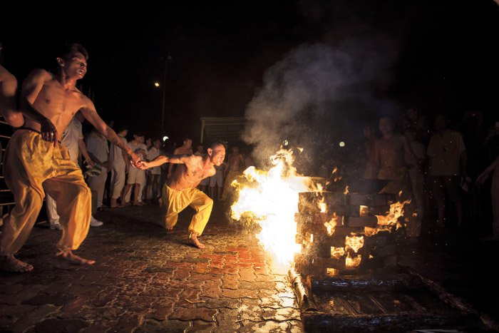 A performance by a bonfire at night shot with a wide aperture