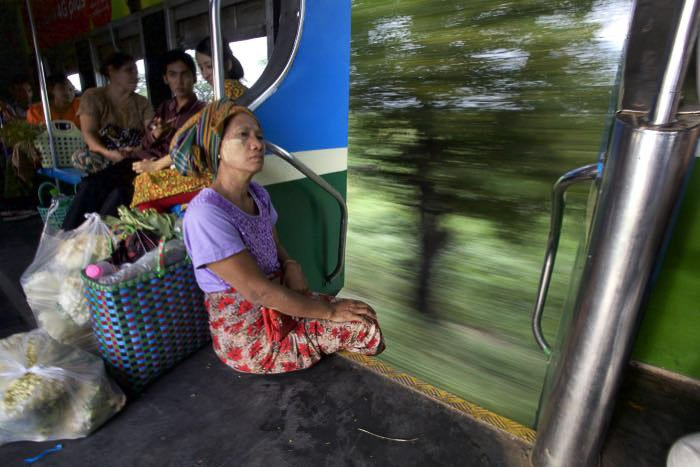A woman sitting on a moving train - wide vs narrow aperture