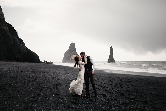 Dreamy wedding portrait of a couple posing on a beach - aesthetics in photography