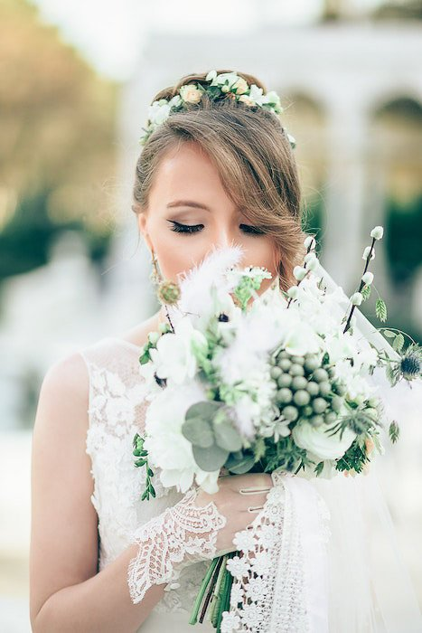 atmospheric close up wedding portrait of a bridesmaid holding a bouquet