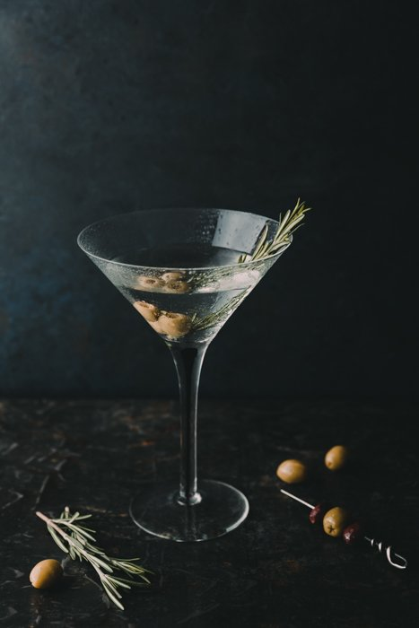 Stylish drink photography of a martini cocktail against a dark background
