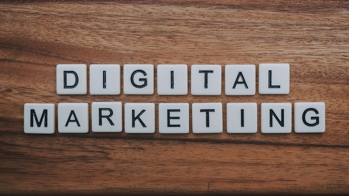 scrabble pieces spelling 'Digital Marketing' on a wooden table