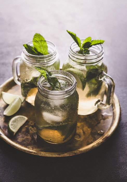 Stylish drink photo of three mojito cocktails on a tray