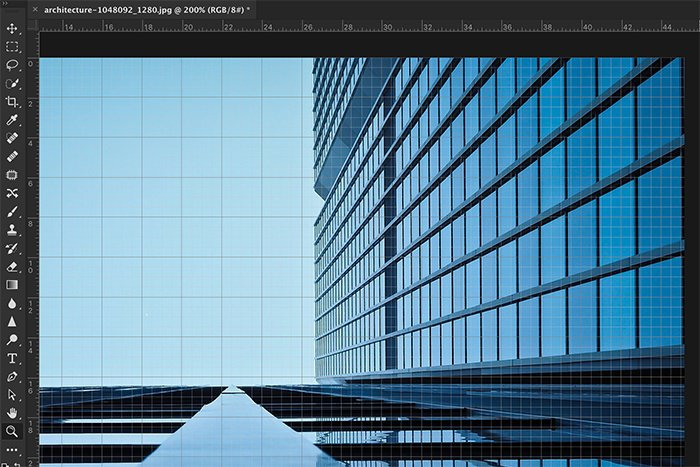 A screenshot showing how to use a grid for editing architecture photography in Photoshop