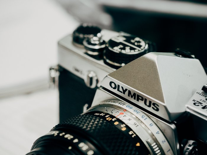 a closeup of an olympus film camera - find camera manuals online