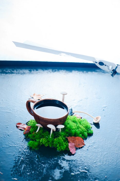 a creative still life featuring reflections in a coffee cup