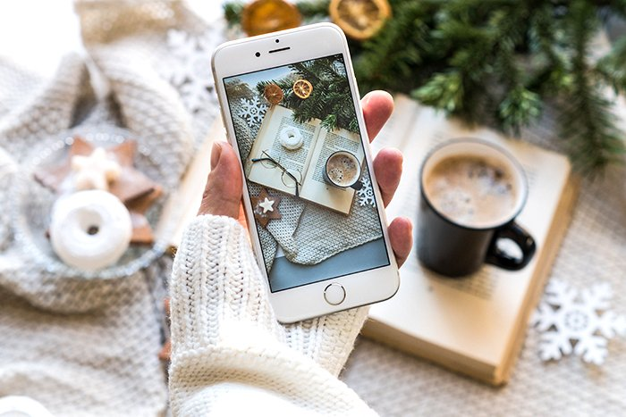 a person staking a smartphone still life photo for instagram