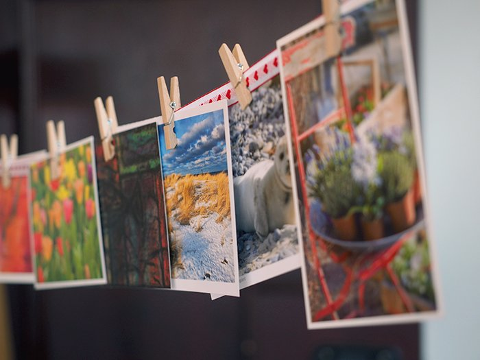 a line of photo prints pegged to a string