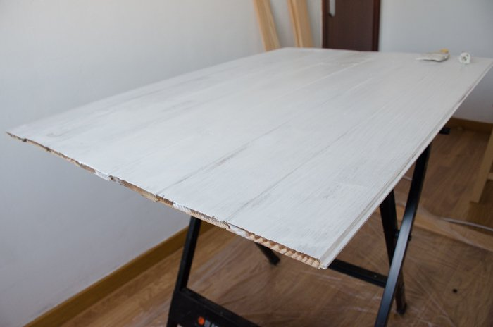 a person making a DIY wood backdrop for photography