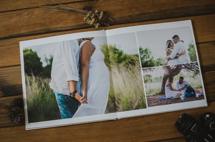 a photography portfolio on a wooden photography backdrop