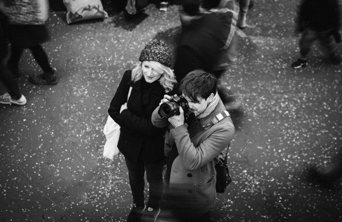 overhead shot of a couple taking street photos