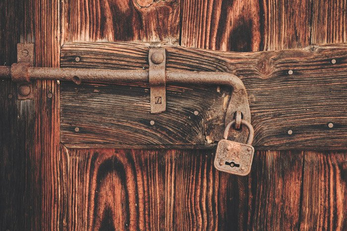 a padlock on a wooden door - symbolism in photography