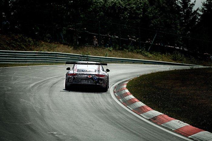 a race car speeding on a race track