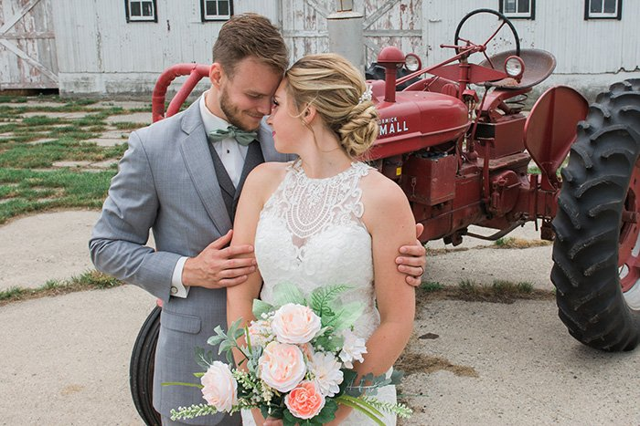 portrait of the newlywed couple embracing at an outdoor wedding photography shoot