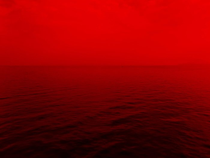 a red toned seascape - symbolism in photography