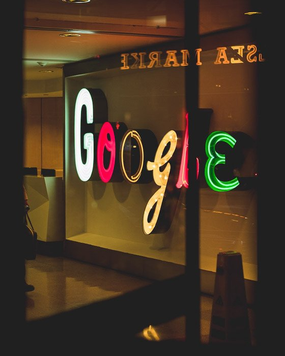 a neon google sign on a window