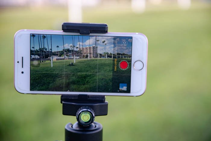 a phone on a tripod outdoors to shoot iphone time lapse photography