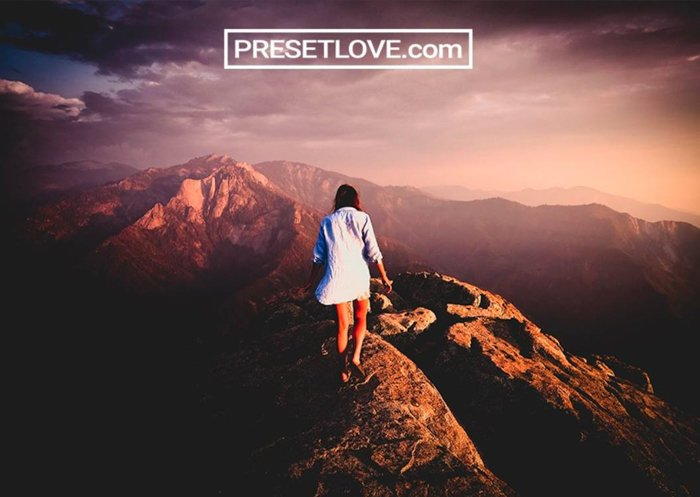 Photo of a girl walking on top of a mountain shadow crusher preset