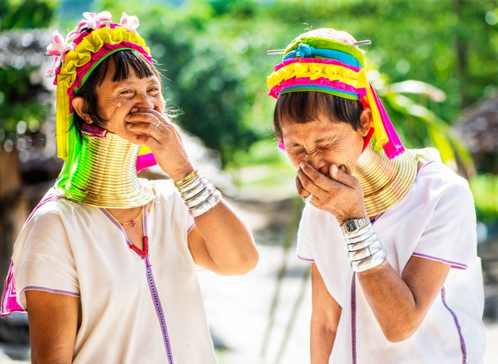 Incident lit portrait of women in traditional costume laughing