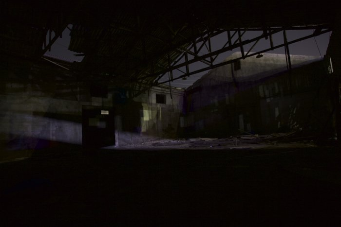 Photo of an abandoned building at nighttime