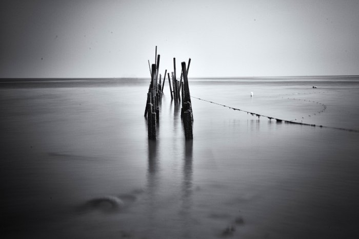 Long exposure photo of a waterscape in black and white
