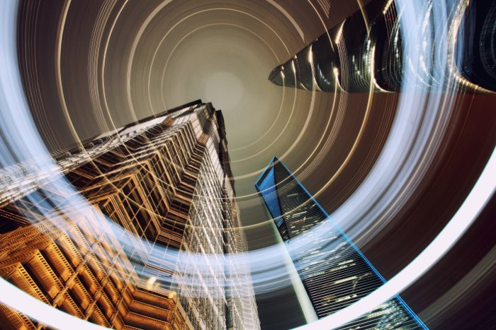 Photo of a cityscape from a worm's eye view with light painting