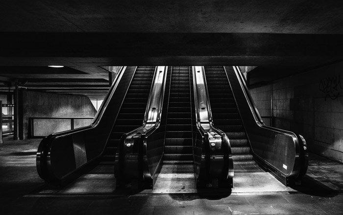 Black and white photo of escalators