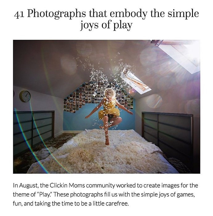 Photo of a girl jumping on a bed with feathers in the air