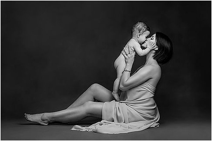 Black and white photo of a mother and her baby by Donatella Nicolini