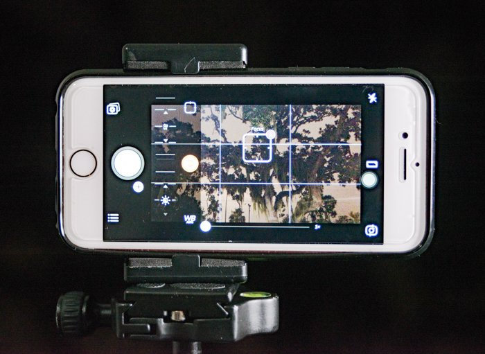 Photo of a white iPhone in photo function with turned on camera grid