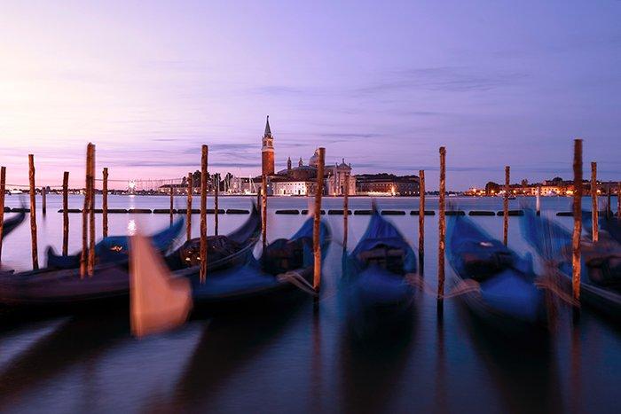 Photo of gondolas in Venice at sunset
