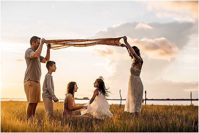 Photo of a family outdoors at sunset by Lennon Photography