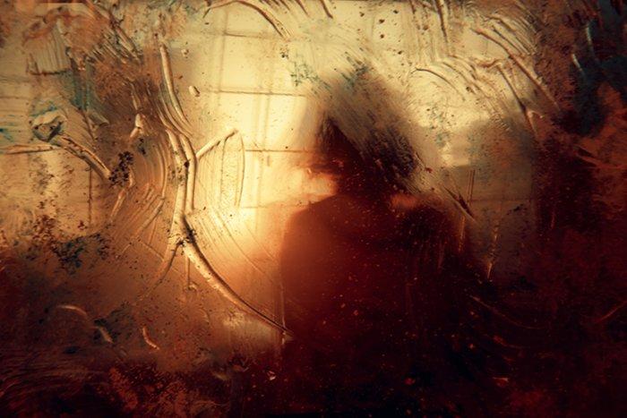 Motion blur photo shot through a window