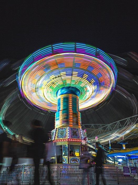 Motion blur photo of a ride at an amusement park